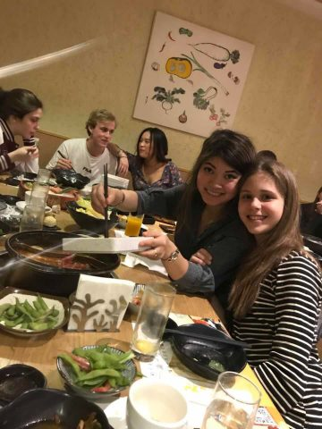 Inge and Fabiola enjoying food